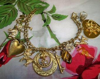 Vintage Monet Charm Bracelet 12 Charms Cupid Heart Poodle Donkey Elephant Fish