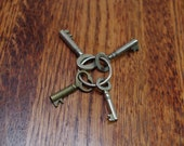 set of four antique keys