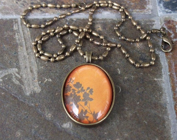 Orange Mod Flower - oval glass pendant and chain