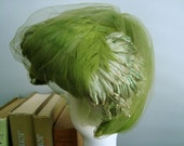 green with envy. gorgeous fascinator hat.