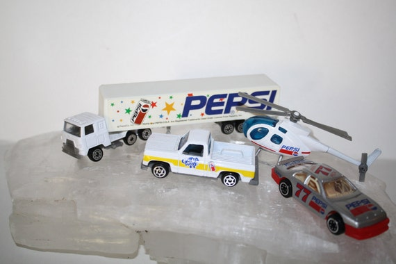PEPSI Cola die cast 5 pc toy lot, Jim Peck no. 77 race car,truck & trailer,Pepsi Gotta Have it truck, helicopter  Lot of 5 toysRare to find