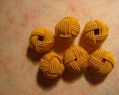 mustard coloured fabric covered beads (No. 6)