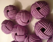 8 purple fabric covered beads