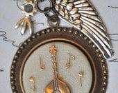 Musician's Aqua Charm Necklace