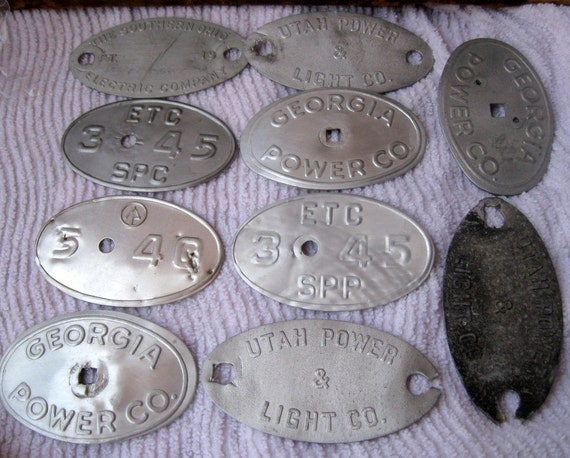 10 Vintage Oval Aluminum Utility Pole Tags