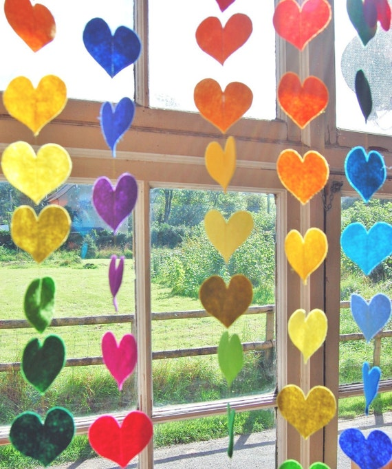 Hanging rainbow hearts a colorful felt decorative garland for Hearts decorations home
