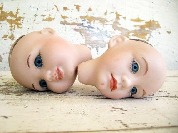 Two Vintage Porcelain Doll Heads