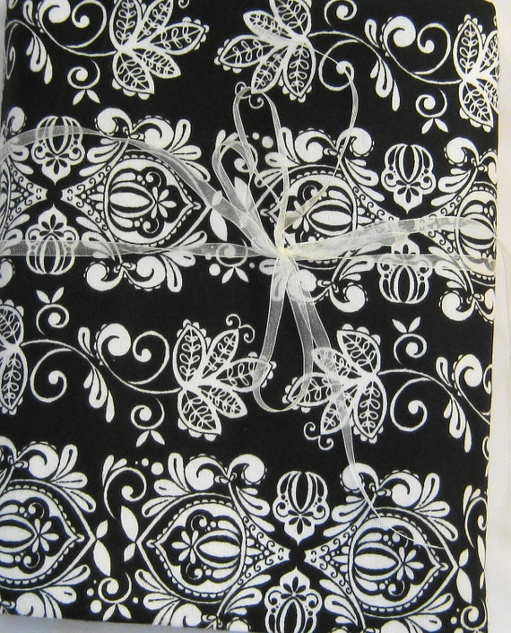 Black and white paisley swaddler