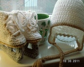 Figure Skate booties and an earflap hat available in three sizes
