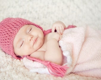 Buy three earflap hats for babies and save