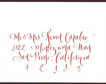 Modern calligraphy envelope addressing red ink