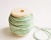 Fern green cotton bakers twine trim on a wood Spool -15 yards