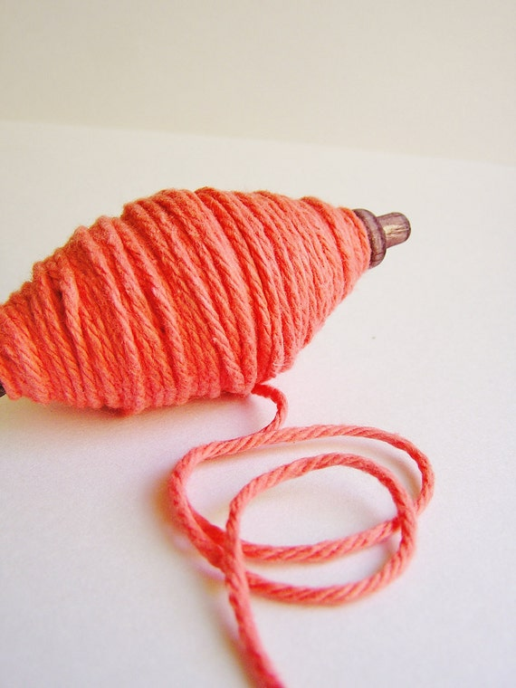 Papaya thick cotton twine on a chocolate spindle