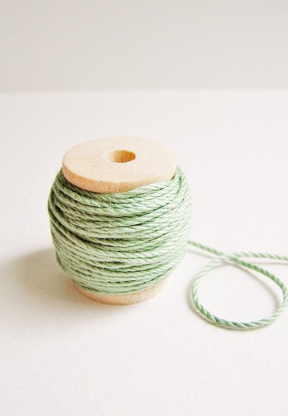 Fern green cotton bakers twine trim on a wood Spool -15 yards