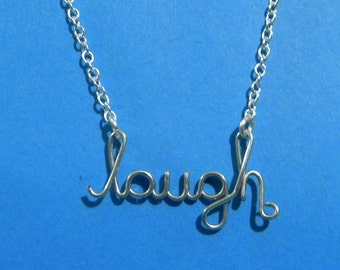 Silver wire LAUGH necklace