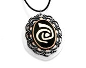 Roswell Necklace, Filigree Pendant with Black & White  Alien Symbol