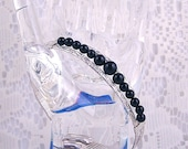Patterned sterling silver and onyx wire wrapped bracelet