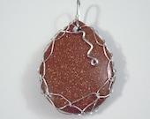 Sterling silver wire wrapped Goldstone teardrop pendant, brooch, pin
