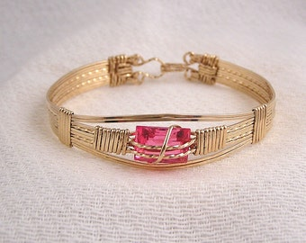 Sofia's Bracelet - Gold fill and synthetic pink stone wire wrapped bracelet