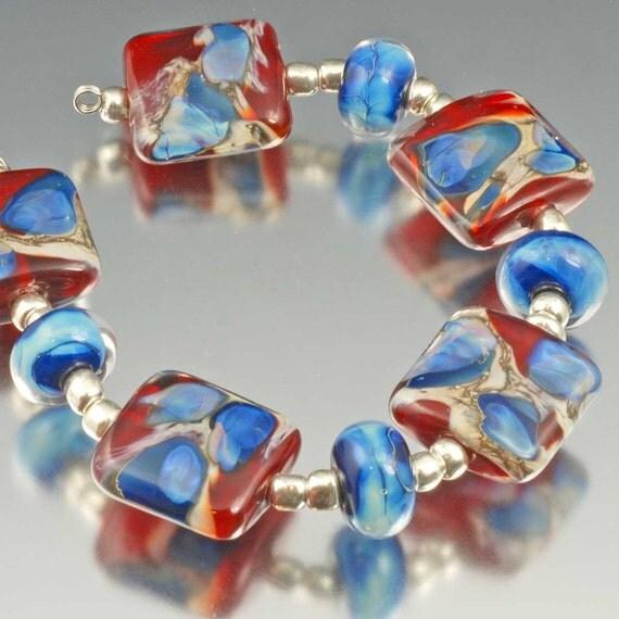Handmade Silver Glass Lampwork Beads - red, blue, deep blue, silvered ivory - Sangre Lagoon