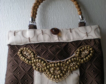 Quilted satin purse with beading trim