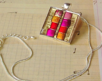 Iridescent Pendant in silver-toned bezel, pink, red and gold