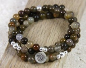 agate short stack. three bracelets. lotus charm.