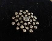 Rhinestone star shaped pin