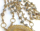 Labradorite gemstone necklace with gold filigree and taupe crystals. EVENING