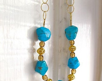 Gold chain and turquoise necklace with filigree & champagne crystals. BLUE SKY