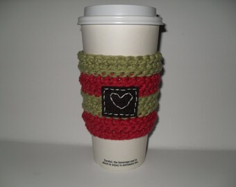 crocheted country christmas cup cozy cup sleeve in country red and country green with hand stitched heart patch