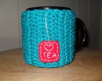handmade crocheted tea mug cozy in peacock blue with red felt hand embroidered tea bag