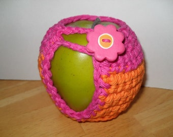 handmade crocheted apple cozy or apple jacket or apple coozie in adorable orange and hot pink eco friendly