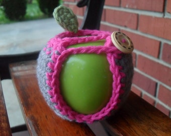 crocheted apple cozy in gray grey and hot pink