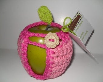 handmade crocheted apple cozy or apple jacket or apple coozie in adorable colors cotton candy pink and hot pink with lime green leaf