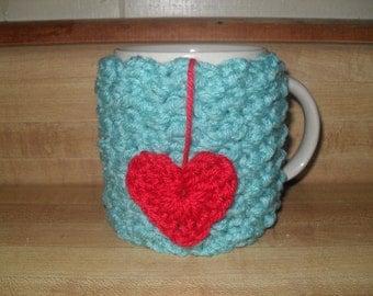 Handmade crocheted coffee mug cozy tea mug cozy in robins egg blue with red hanging heart