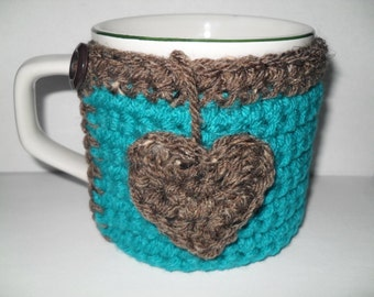 crocheted coffee mug cozy or tea cup cozy in beautiful peacock blue trimmed in barley brown with heart tea bag