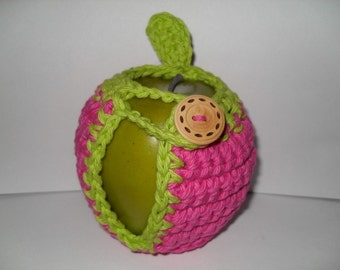 crocheted apple cozy or fruit cozy in hot pink and lime green with leaf eco friendly