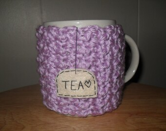 Crocheted tea cup cozy or tea mug cozy in light purple lavender lilac