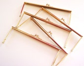 5 Gold tone purse frames in 7 inch X 2.5 inch size