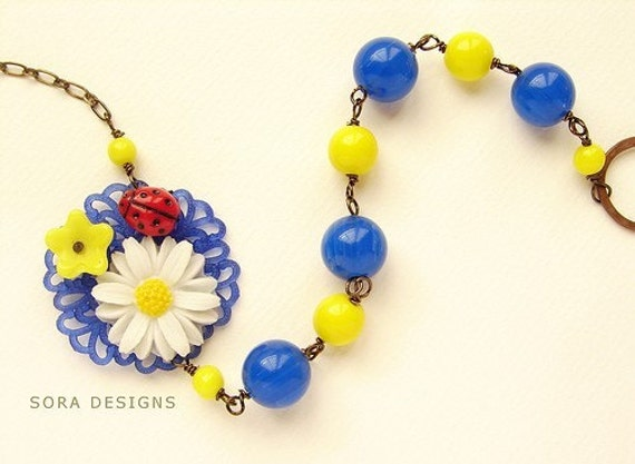 Ladybug Daisy necklace - vintage daisy and glass ladybug repurposed necklace bright blue yellow red necklace