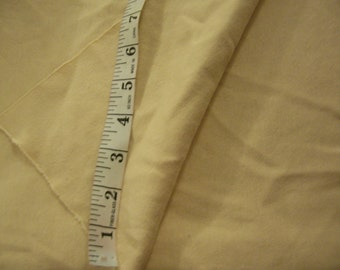 "Vintage Tannish Banana color  cotton/poly stretch t-shirt fabric 64"" length x 70"" width"