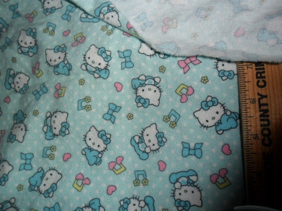 "Hello Kitty Flannel Fabric in Blue - 40"" wide x 32"" long"