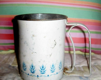 Vintage tin hand sifter