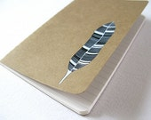 striped feather . handpainted moleskine notebook with ruled pages . by natasha newton