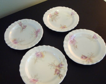 Price reduced........Four sweet Haviland Limoges butter plates