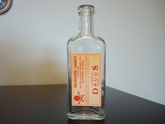 Old apothecary medicine bottle with vintage label