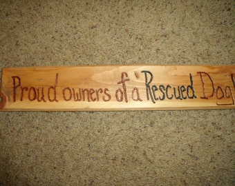"SIGN/ Plaque ""Proud Owners of a RESCUED DOG""---rusTic engraVed PiNe-17"" X 3""--2 choices of signs"