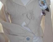 Designer Vintage style bolero cardigan with long puff sleeves.