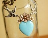 a delicate tattoo (pink on blue) - vintage enamel flower blue glass heart necklace